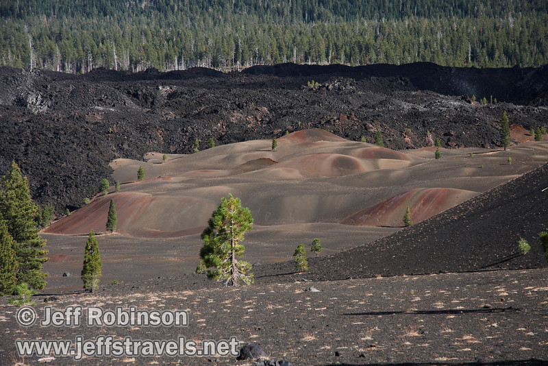 The left edge of Cinder Cone, with the Painted Dunes (mid-ground) and the Fantastic Lava Beds (background) to its left (9/11/2009, Cinder Cone hike, Lassen NP)