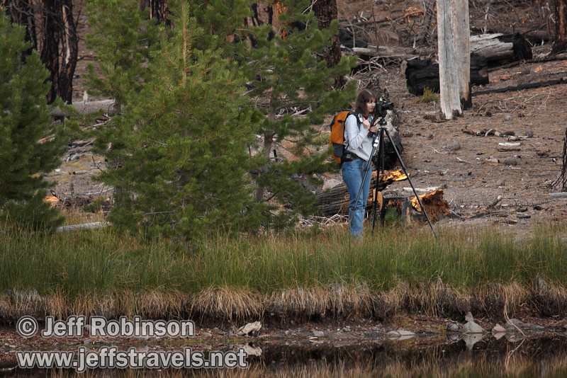 Lynda taking photos on the far shore with her camera on a tripod (9/8/2009, Reflection Lake, Lassen NP)