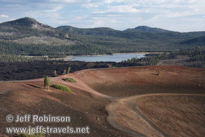 Views of the redish rock, trees, and trails on the SE side of Cinder Cone, with the Painted Dunes, Fantastic Lava Beds, and Snag Lake visible (9/11/2009, Cinder Cone hike, Lassen NP)