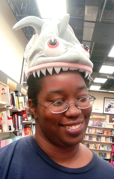 A shark is eating Chastity's head!