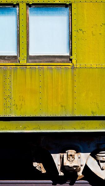 <em>Bygone Transport</em> Detail of an old passenger car, Barstow, CA Copyright 2008 Ken Walsh