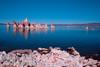 Tufa in Mono Lake, with blue sky reflecting off the lake. (South Tufa, Mono Lake 2002)