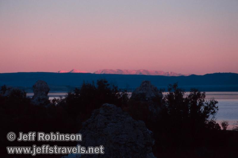 Sun setting on distant mountains over Mono Lake and foreground tufa in shade. (Fall 2002, Mono Lake Park, Mono Lake)