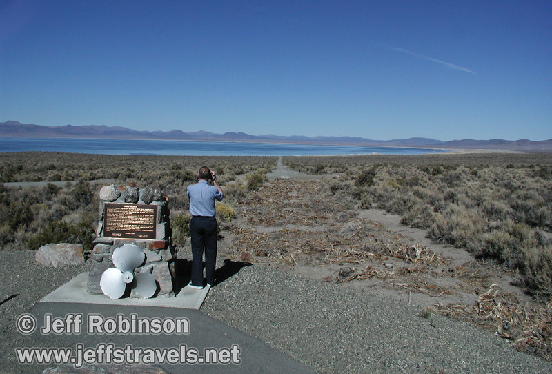 Dad taking video beside a Navy Beach sign, with the road to Navy Beach leading down to Mono Lake. (Mono Lake 2002)