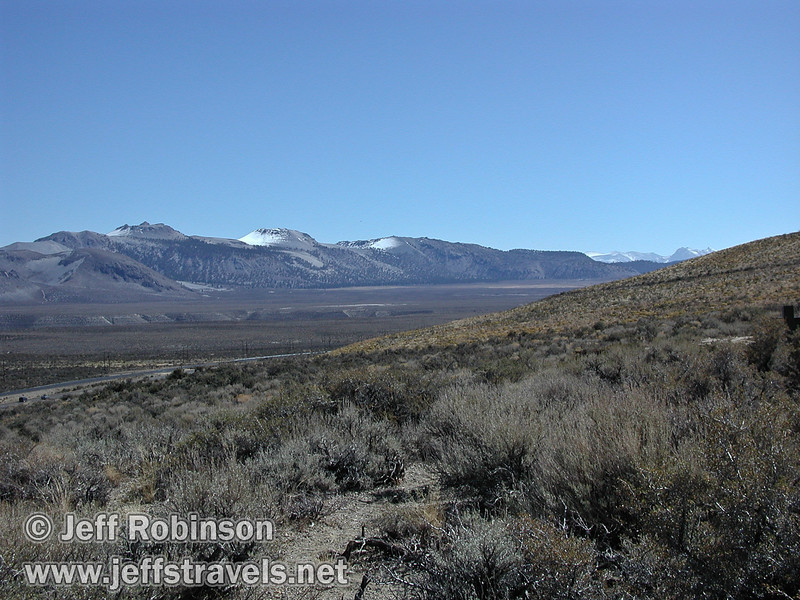 View just to the south (right) of Mono Lake with distant snow-capped mountains. Seen from vista point near Lee Vining with highway 395 in the foreground (Mono Lake 2002)