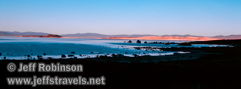 Westerly view of late sun on Paoha Island with silhouette of tufa & shoreline in foreground. Seen from the parking lot by Picnic Shortcut Rd. a bit NW of the visitor center. (South Tufa, Mono Lake 2002)