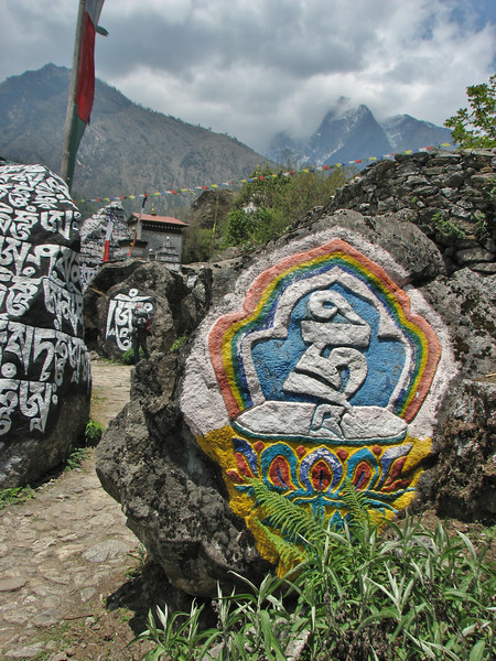 Prayer stones. Passing left, Lukla 2800m-Monjo 2900m