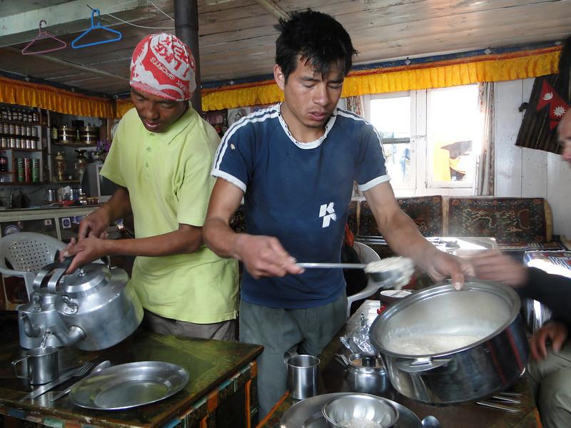 Serving food, kitchenboys Tenzing and Radzou,  Namche Bazar 3450m