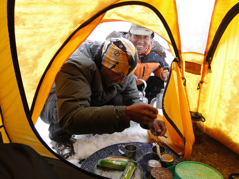 Mingma and Tenzi bring thee and biscuits, Camp Kare 4950m