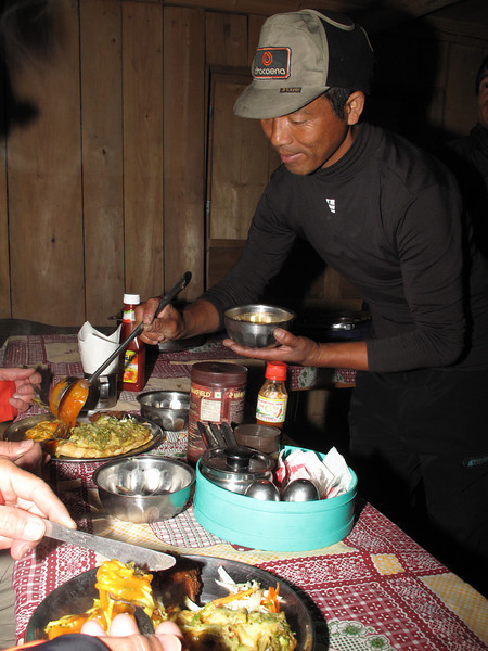 Tenzi serving our meal, Kothe 3700m