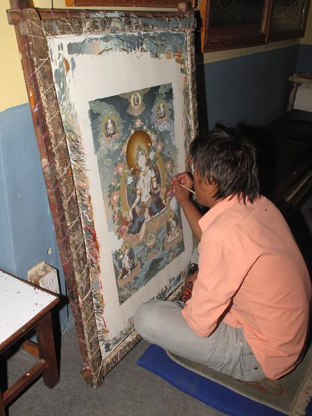 Student working at Thanka painting school, Baktapur Palace Area