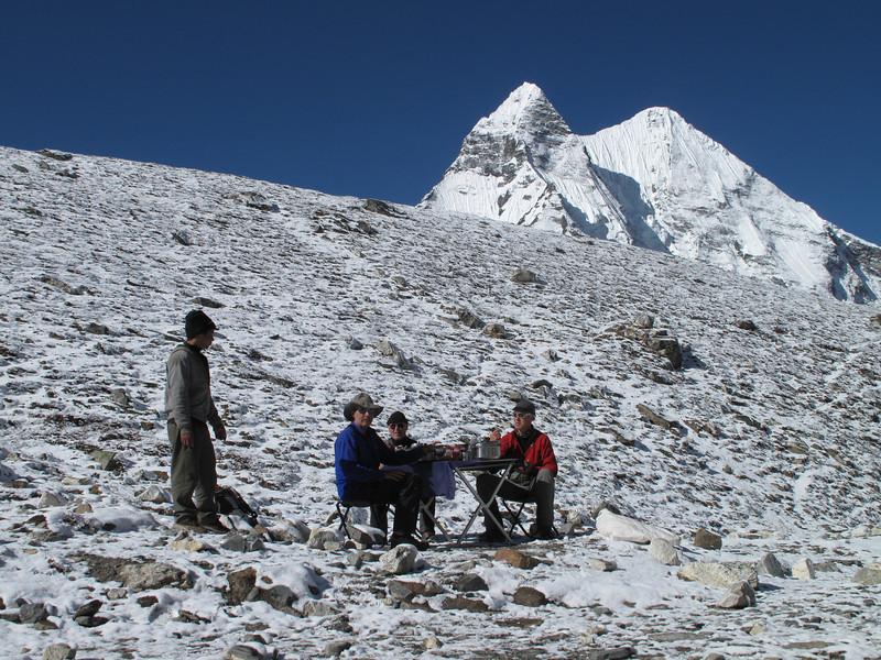 Radzou serving breakfast,  Island Peak Base Camp 5000m
