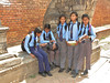School children near figure of Bhairab, 17th Century, Baktapur Palace Area