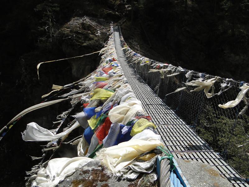 Suspension bridge with prayer-flags, Monjo 2900m-Namche Bazaar-Tengboche-Deboche 3630m