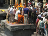 Hindu cremation ceremony of a pilot crashed by a air-accident, Holy Bagmati river, Pashupatinath, Kathmandu