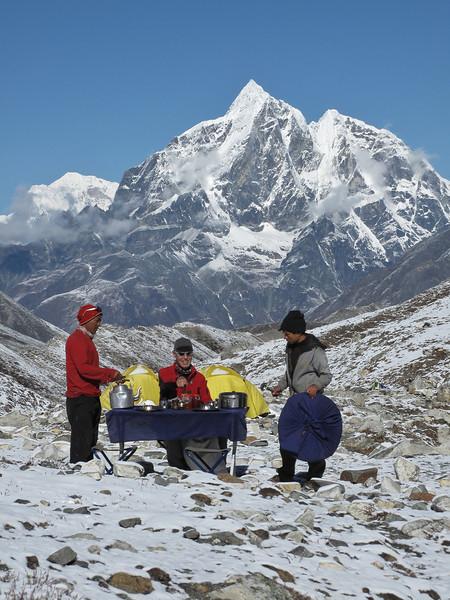Tenzi and Radzou serving breakfast,  Island Peak Base Camp 5000m
