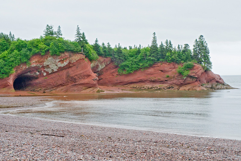 At a restaurant in St. Martins, New Brunswick, we had a view of these sea caves.  They have been carved out of the sandstone by the action of the waves.