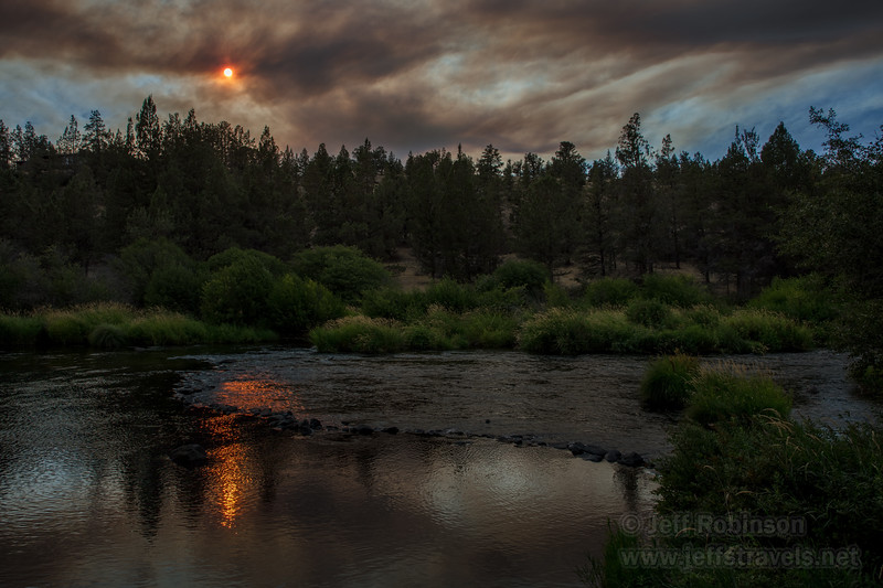 The red sun through a smoke cloud and its reflection in the Deschutes River (8/18/2017, Cline Falls State Scenic Viewpoint, Madras eclipse trip)<br /> EF24-105mm f/4L IS II USM @ 28mm f8 1/80s ISO100