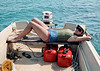 Ruth catching some rays between dives.  The waters around Enewetak are fairly warm but you always get cold diving.