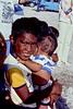A young Enewetak Islander boy holding a baby.