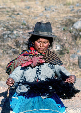 A Peruvian woman working her wool. She was sitting near ruins letting tourists take pictures of her for tips.