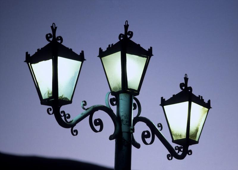 A Cusco street light at dusk.