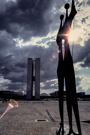 A sentinel style sculpture near the Congress Towers in Brasilia. Sometimes shooting into the sun to accentuate lens flare works.