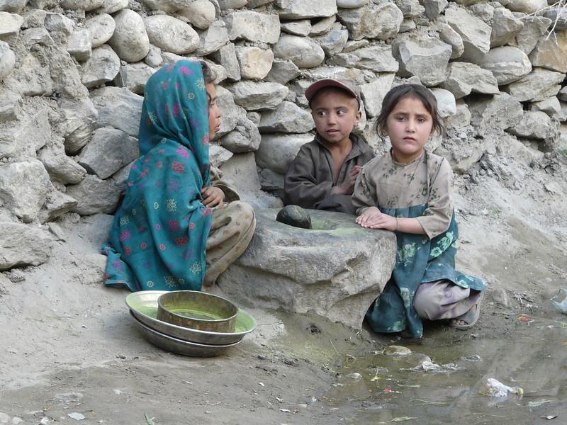 children grinding herbs (Skardu 2268m.)