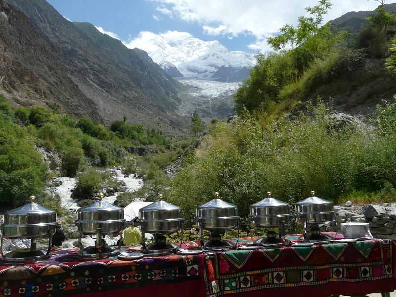 diner with on the background Rakaposhi 7788m. (near Karimabad)