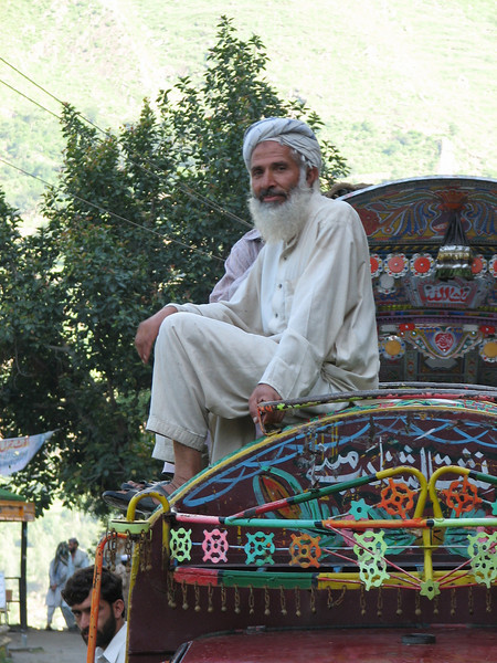 sitting on the roof of the car (near Islamabad 528m.)