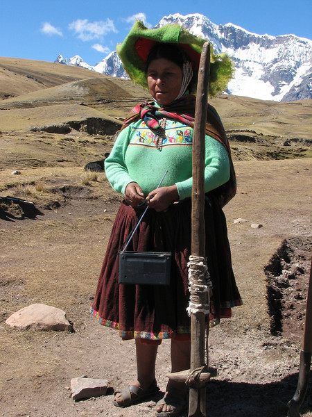 women with an Inca tool and a portable radio. (Peru 2009, Nevado Ausangate)