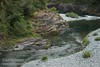 Textured rock walls on the side of the South Fork Smith River, seen looking downstream from the bridge on South Fork Road (6/30/2008, east of Jedediah Smith Redwoods SP, Redwoods trip)
