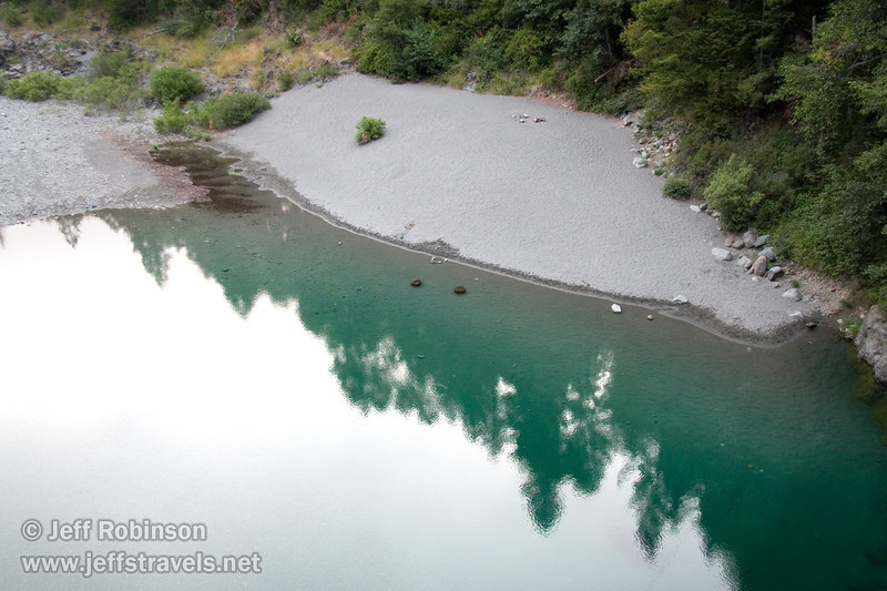 Calm pool with grey sandy beach and turquoise water on the South Fork Smith River, seen looking downstream from the bridge on South Fork Road (6/30/2008, east of Jedediah Smith Redwoods SP, Redwoods trip)