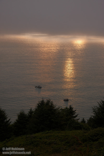 Sunlight reflecting off the ocean at the coastline with a fog bank above (7/1/2008, Coastal Drive between High Bluff Overlook and the World War II Radar Station,  Redwood NP, Redwoods trip)