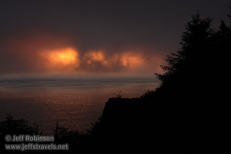 Foggy sunset over the ocean with coastal rocks & trees in foreground (7/1/2008, Coastal Drive at the World War II Radar Station,  Redwood NP, Redwoods trip)