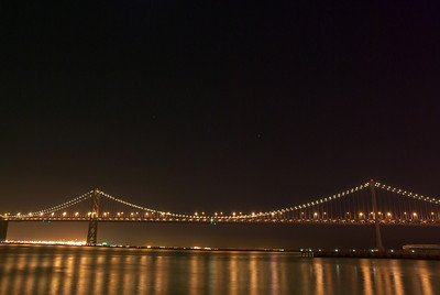 The bay bridge with Orion visible above it.