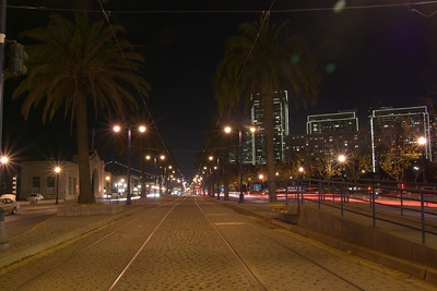 A view down the light rail / trolley tracks running down the embarcadero near Pier 15.