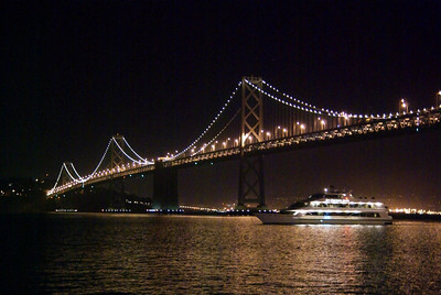 The bridge with a large party boat coming underneath