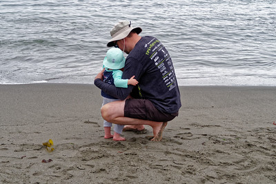 Linnea prepares to take her first step into the ocean.