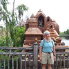 Jeane poses in front of the fake Buddhist shrine in the foothills of Everest.