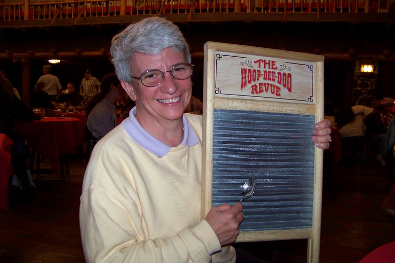 """Our evening's dinner and entertainment is at the Hoop-de-Doo Revue in Fort Wilderness, a """"frontier"""" style show.  Some guests are recruited to play the washboard."""
