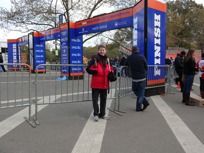 Patti -- pretty bummed about having to see the finish line this way rather than hobbling under it, aching and cold.  Well, maybe she's cold anyway.