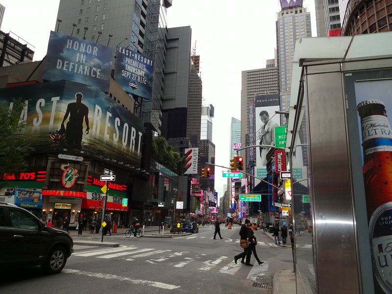 We pass through Times Square on our way to a marathon shuttle stop.