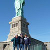 Patti tries to organize the wandering family for a photo at the Statue of Liberty
