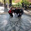 Linda, Laura, and Lane pose in front of the memorial to John Lennon in the Strawberry Fields area of Central Park.