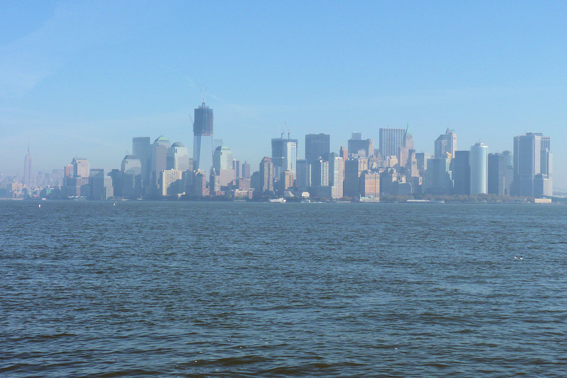 NYC Skyline from Liberty Island.  The tall building still under construction is the new One World Trade Center, trying to fill the hole in the skyline left when the twin towers came down.