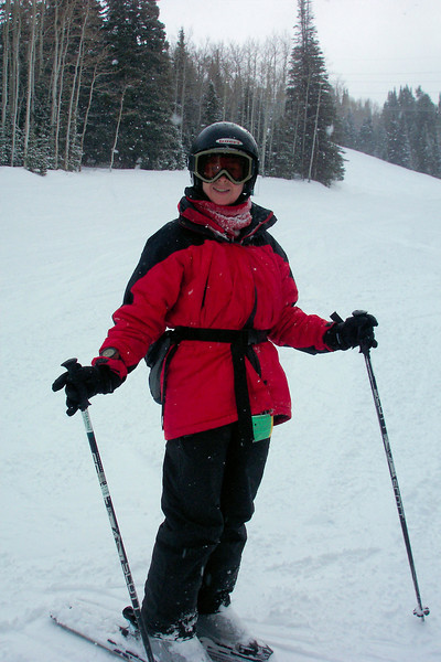 Fresh snow coming down, but that snow pack in Patti's balaclava is from a wipeout!