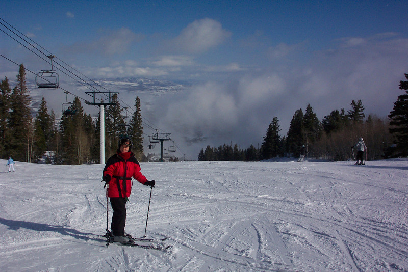 Patti is above the clouds in the valley, but will meet them soon enough.