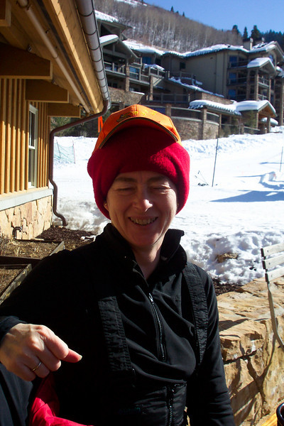 Patti decides her ears are a little too cool without her ski helmet, but finds that her balaclava suffices nicely.