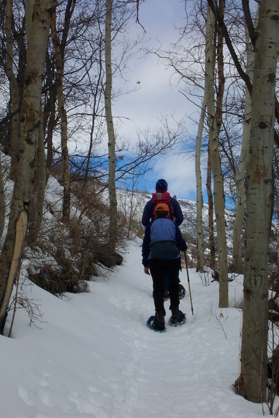 We take a break from downhill skiing by lacing up our snowshoes.
